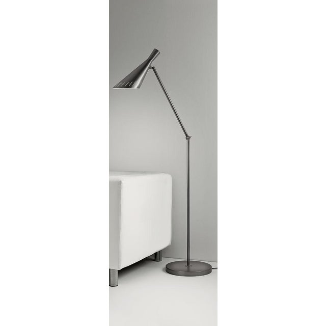 Black bronze floor light with adjustable head. The shade is is cone shaped and has decorative slots to allow light spill....