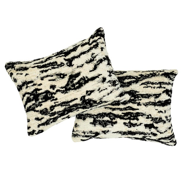 """This 12"""" x 16"""" pillow features Serengeti in Tigre Blanc. A stylized animal pattern that combines luxury and glamour,..."""