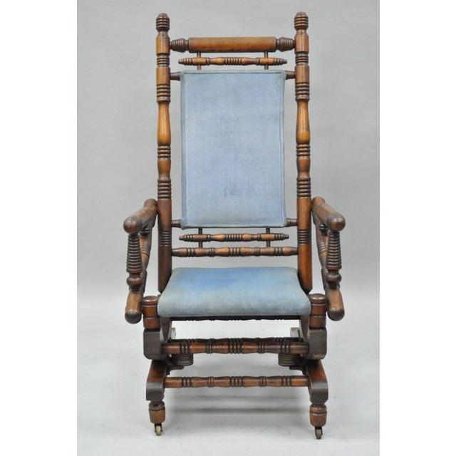 An Antique American Eastlake Victorian Period Platform Rocking Chair. Details: Solid Walnut Turned Construction, Platform...