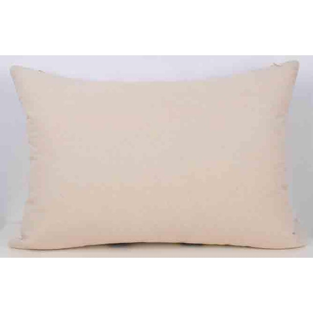 Silk Atlas Accent Lumbar Throw Pillow Reverse is a solid textile Pillow has a zipper for closure A high quality down...