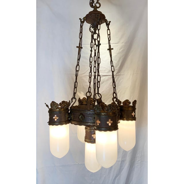 This chandelier is a beautiful example of gothic style with mixed metals from the 19th Century. The 5 original milk glass...