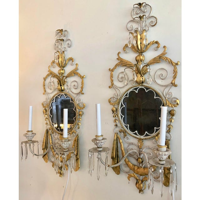 Incredible pair of Mid Century Italian wall sconces. Large and very impressive. Dark distressed mirror with clear crystals...
