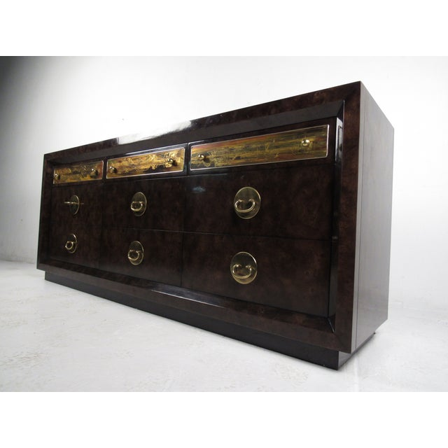 This Mastercraft dresser features acid-etched designs, unique brass pulls, and quality vintage construction. Wonderful...