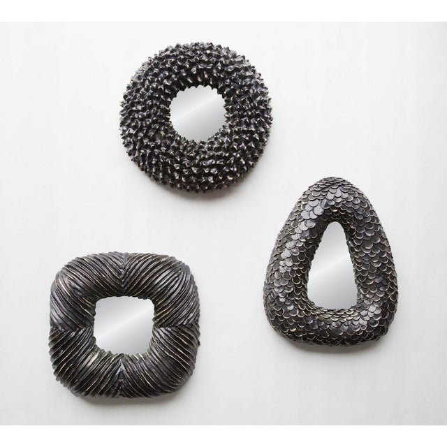 Hand-made by artist Melissa Cromwell of gritty white stoneware with an added textural surface and a matte black glaze....