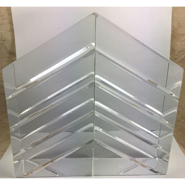 Pair of Lucite bookends by Astrolite. The pair are in the form of thick trapezoids with the top edges angled 45 degrees....