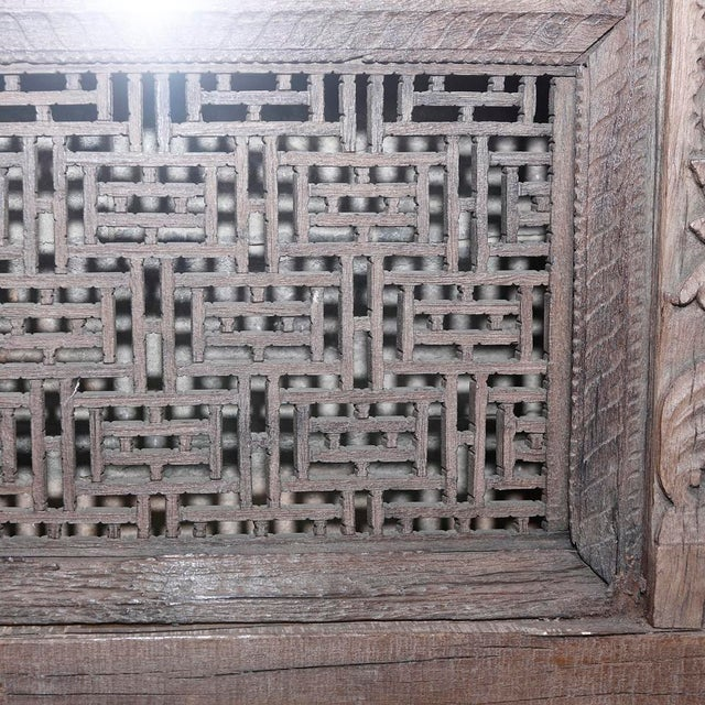 This Jarokha carved mirror, made from an old window frame from a Haveli in Mandawa, India, features an intricately carved...