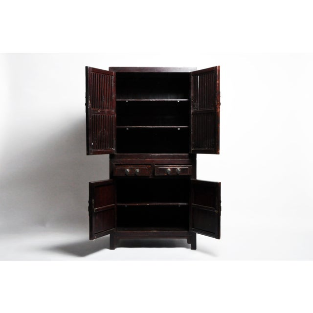 Chinese furniture is known for its practicality, beauty, and sturdy construction. This storage cabinet features lattice...