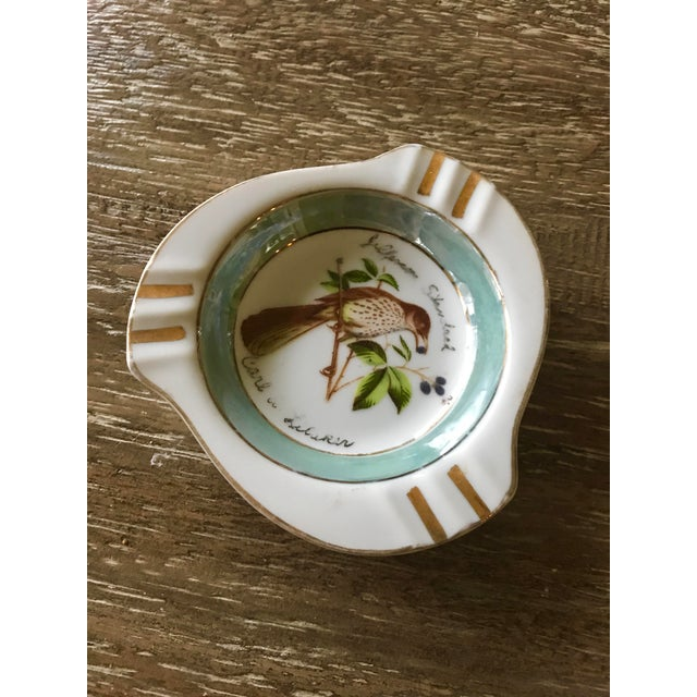 This little charming vintage ash tray is embellished with an esquistedly painted bird perched on a blue berry branch....