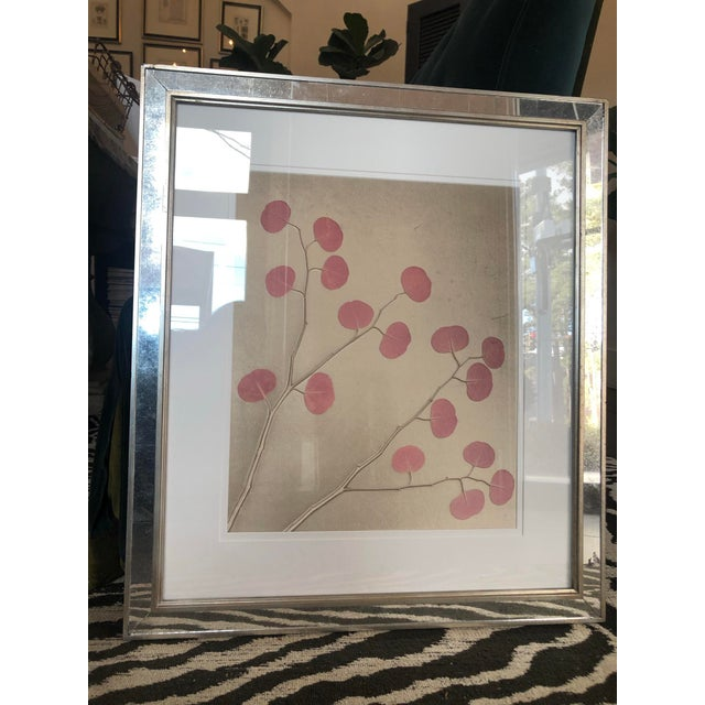 Organic nature pressing on velvet. Pink and cream design on a white matte with a mirrored frame. Artist is Aviva Stanoff.