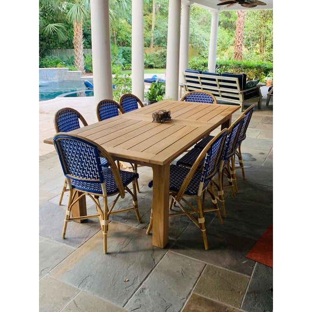 Set of Ten French Bistro Chairs in a beautiful royal blue/ivory zigzag pattern (table pictured is not included). Crafted...