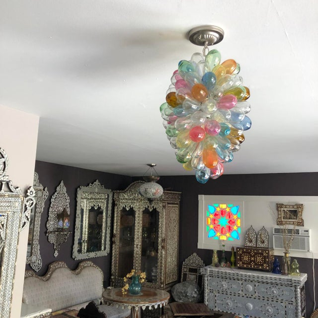 This fun colorful sculptural light fixture is composed of individual handblown balloon shaped pieces, individually...
