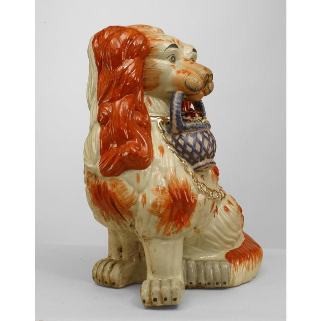 Pair of English Victorian style large porcelain Stafforshire porcelain figure of orange and white seated spaniel dogs...
