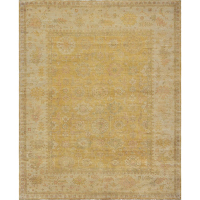 This brand new Oushak from Kashmir features a subtle gold color field and a decorative design. 100% natural wool pile.