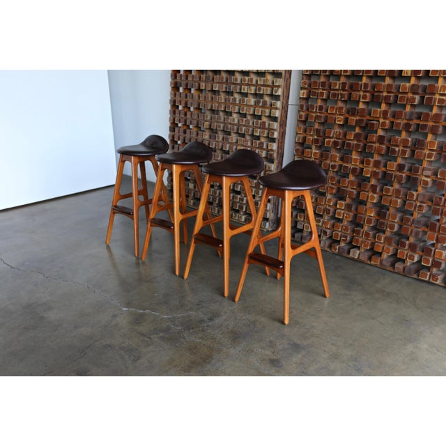 Set of four teak, rosewood & leather barstools by Erik Buch or Erick Buck for O.D. Mobler, Denmark.