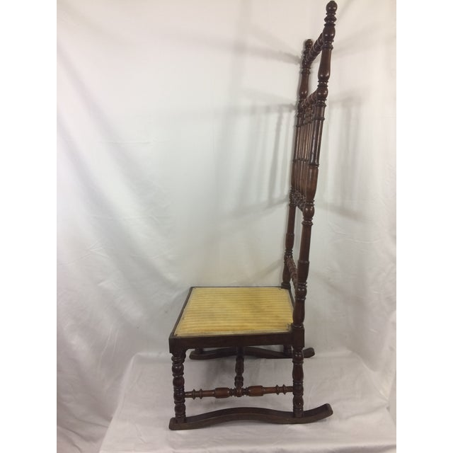 This delightful high back chair dates from about 1890 and has golden yellow upholstery. In good condition, with minor wear...