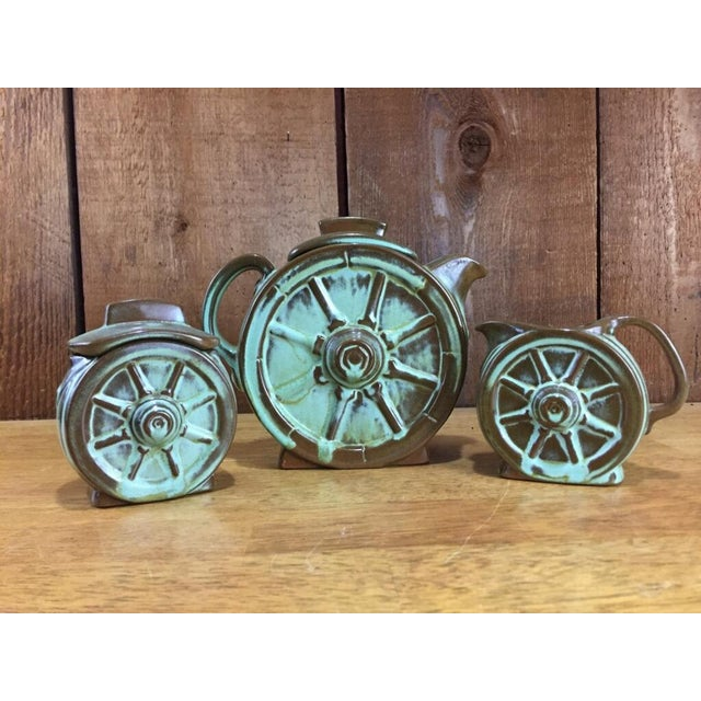 Mint condition Frankoma prairie green wagon wheel coffee pot, creamer and sugar bowl set. This beautiful pottery would...