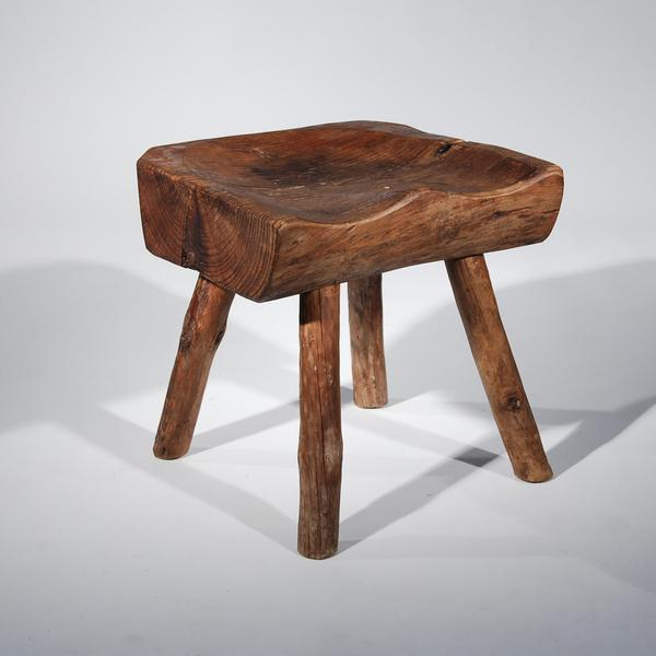 A Small but Sturdy Wooden Stool for Sitting or Putting Legs up on.