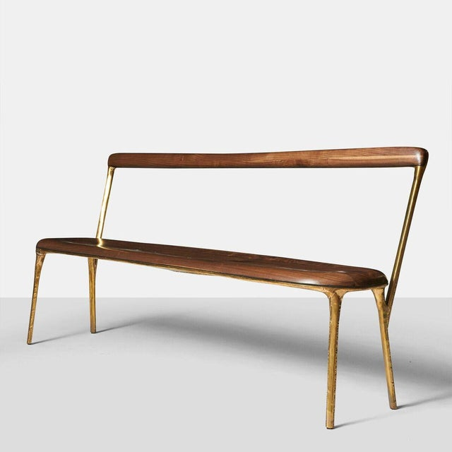 Bench with Back in Brass A bench in hand worked brass with walnut seat and backrest. Incredible detail on all areas...