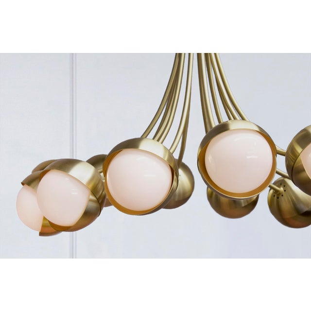 The Benedict 12-light chandelier puts the Benedict light assembly on full display. Laid out on a gently arching array,...