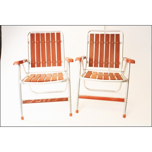 Vintage Mid Century ALUMINUM FOLDING CHAIRS. Redwood slat back & bottoms. Nice plastic arms. Rounded legs. All original....