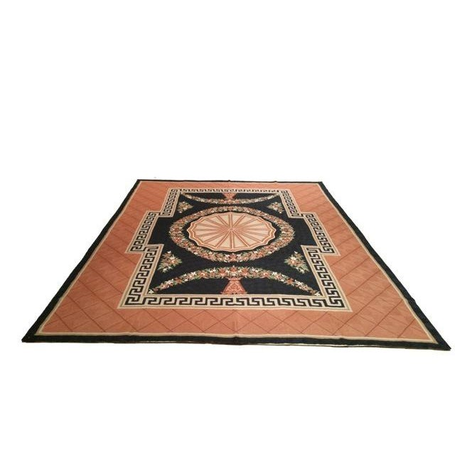 Infuse a touch of elegance to high-traffic areas of your home with this durable wool rug in colors of brick red, black, a...