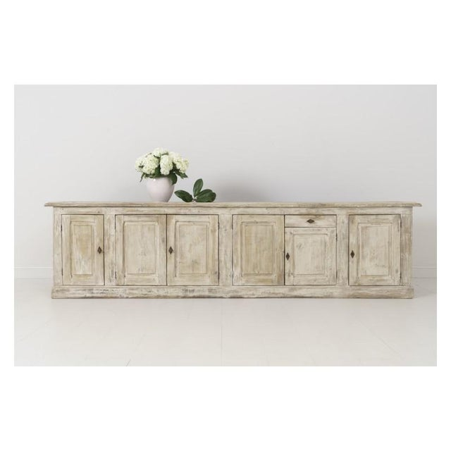 A 19th century French Louis Philippe enfilade found in Provence. This beautiful six-door and one drawer sideboard or...