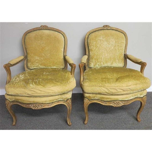 Pair of elegant French or Italian Louis XV armchairs with ample seats, and very comfortable. Age appropriate wear...