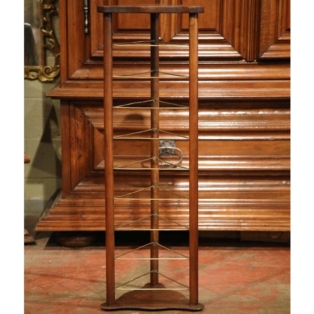 This useful, antique fruitwood plate stand was carved in France, circa 1880. The unique corner display piece features...