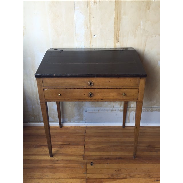 This small Italian antique writing desk is painted a gold color on the base and the top, which lifts up, is black. Overall...