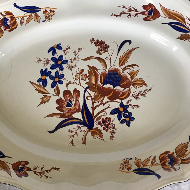 """Vintage Luneville faience serving dish in """"Paquerette"""" pattern. Floral motif in various shades of brown/orange/yellow with..."""