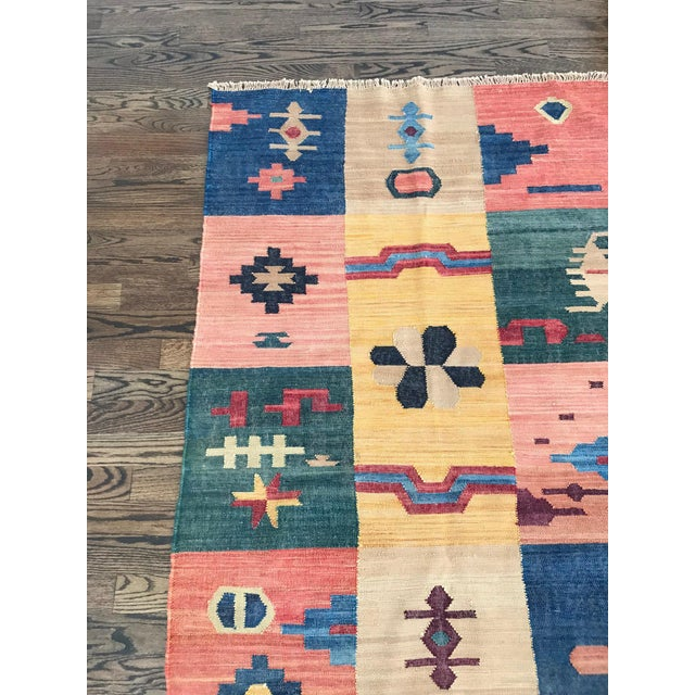 The design of this flatweave kilim-like rug is based on antique tribal motifs from the American Southwest and Pre-...