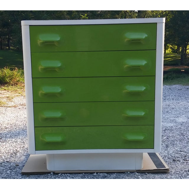 A Broyhill Premier Chapter One tall dresser in Lime Green. Styled in the manner of the Raymond Loewy pieces, the dresser...