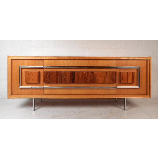 This stunning vintage modern two-tone sideboard offers plenty of room for storage within its three large drawers and two...