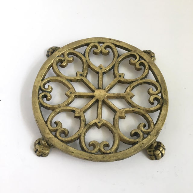 A darling vintage brass trivet with claw feet and ornate detailing. This little piece is so charming and unique. It would...