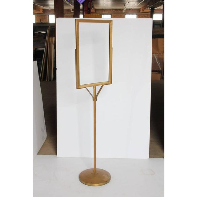 """1930s department store free standing metal sign stand. It holds sign 13.5"""" by 21.5"""". This piece would be great to hold a..."""