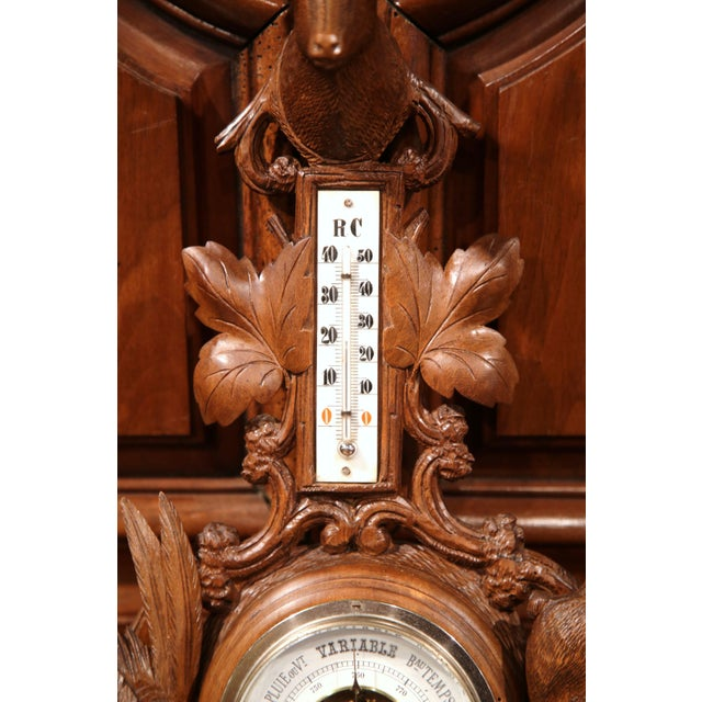 This fine antique wall hanging barometer was crafted in France, circa 1880. The weather and temperature reading device is...