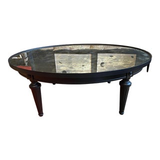 Hollywood Regency Black Coffee Table With an Antique Mirror Top For Sale