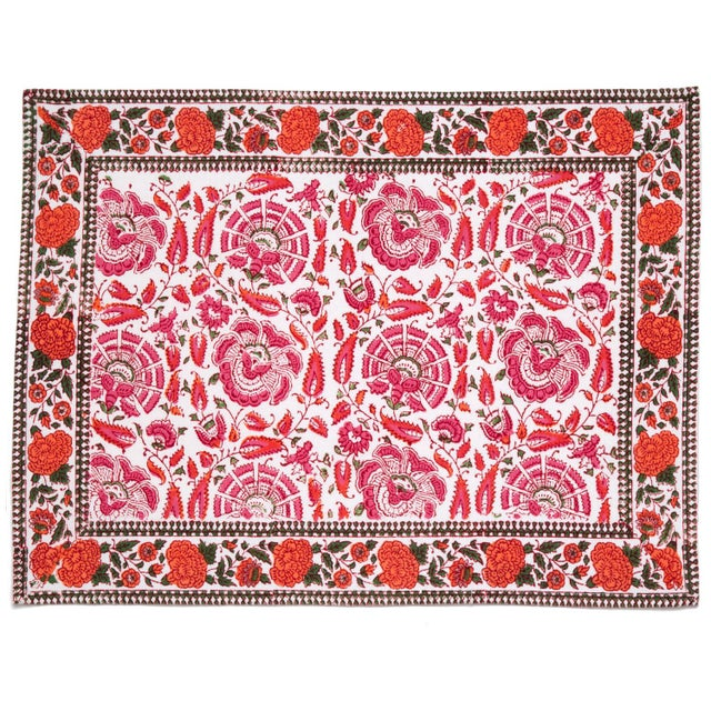 The classic Riyad design depicting elaborate flowers and vines stands out beautifully in the celebrated Indian color...