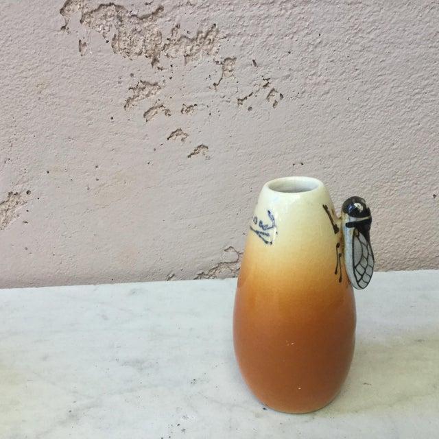 Small Majolica yellow vase with a cicada signed Sicard circa 1950. Provencal style.