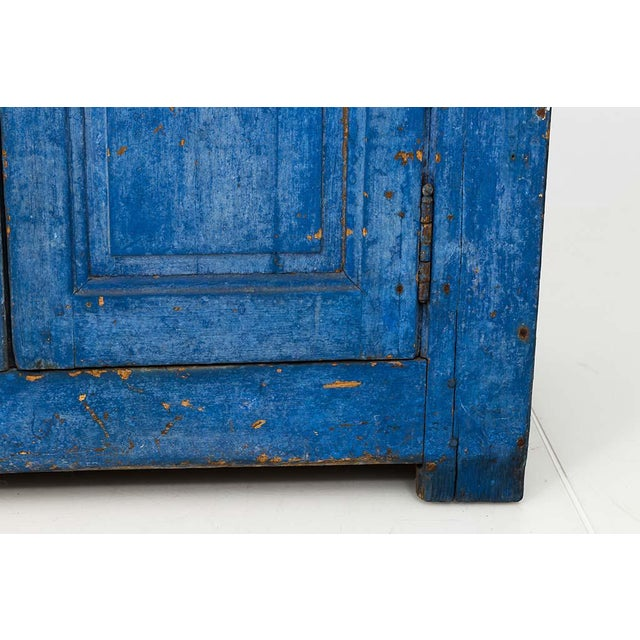 INQUIRE ABOUT SHIPPING PRIOR TO PURCHASE This striking French Country cabinet has a brilliant indigo color later paint....