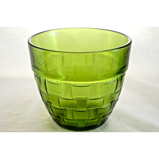 "Deep vivid green vintage glass bowl in a basket weave pattern. Marked with Anchor Hocking hallmark as well as ""USA.""."