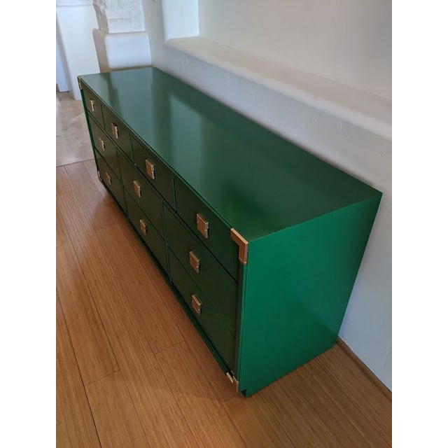 Features original brass pulls. The corners have brass cups. Dovetail drawers are very clean and slide beautifully....