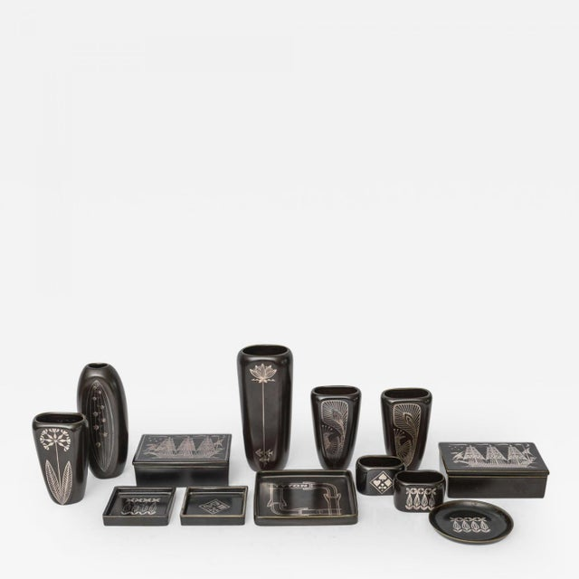 In various vases and vessels, in rare black glaze, markings to underside, priced individually, see dealer. Pieces can be...