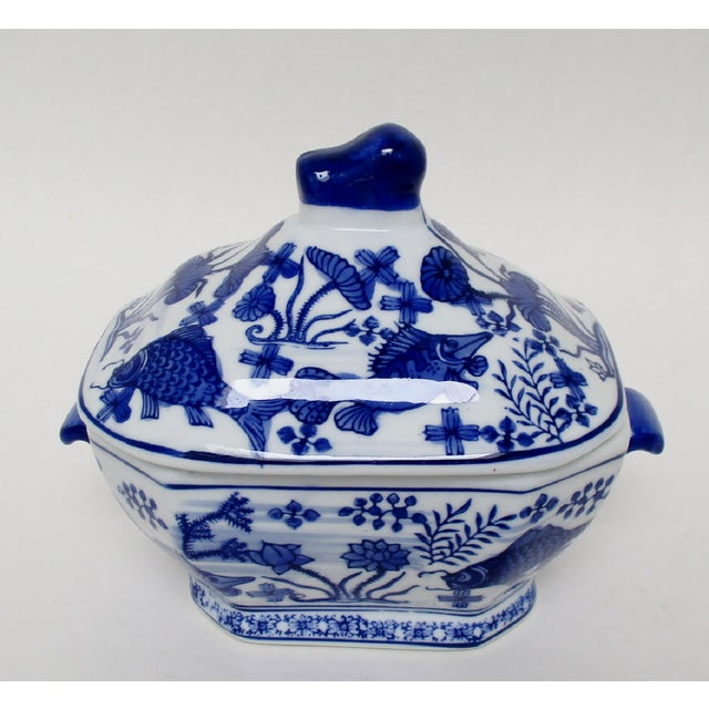 Chinese lidded porcelain tureen with hand-painted fish motif in blue on white glaze. Suitable as an individual tureen or...