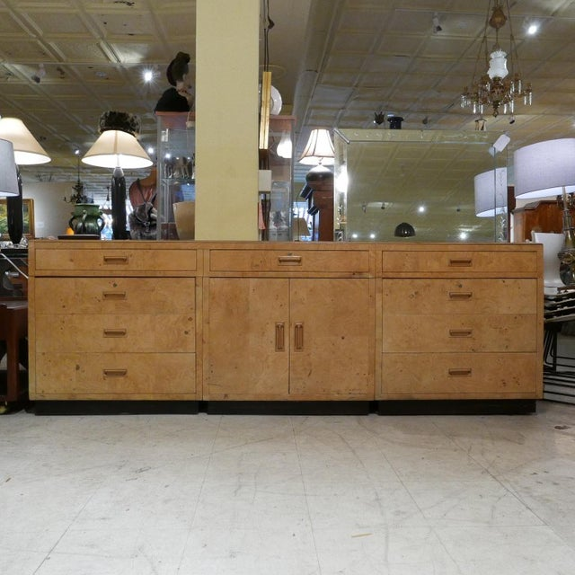 Stunning and solid piece consists of 3 separate chests that make up the bottom portion while the top three drawers is a...