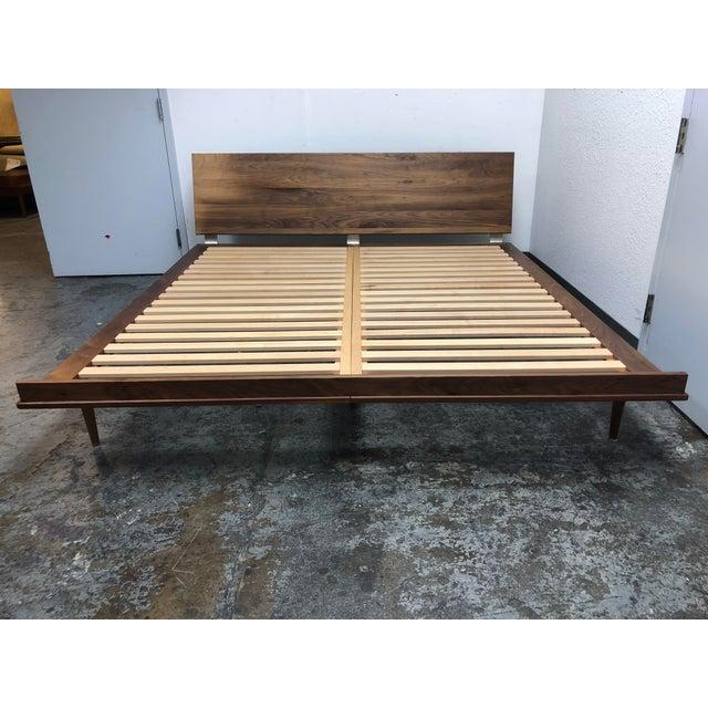 Design Plus Gallery presents elegant minimalism incarnate. This Nelson Thin-Edge Eastern King Bed in Walnut by Herman...