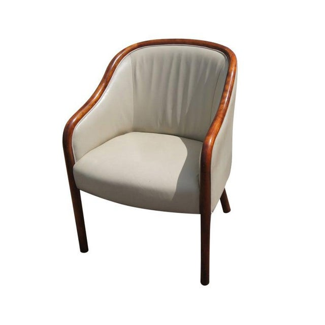 A pair of mid century modern armchairs designed by Ward Bennett and made by Brickel. Walnut frames with gray leather...