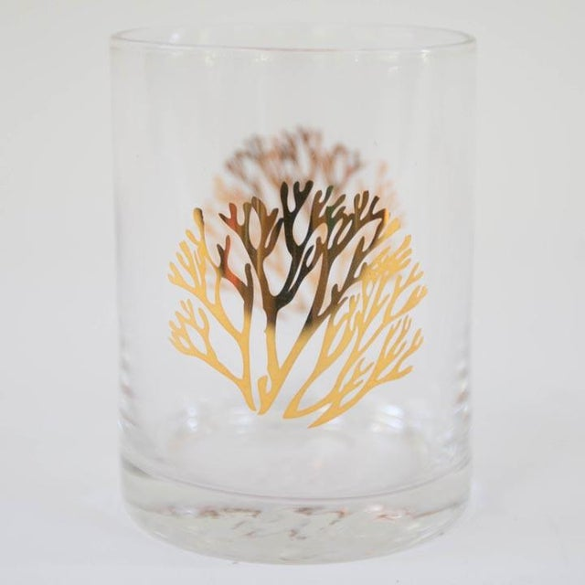 Set of 4 gilded coral cocktail glasses. Hand wash.