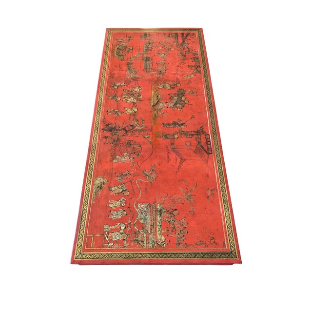 A stunning Chinese coffee table in red lacquer with hand-painted gilt decoration. The tabletop is an older panel, most...