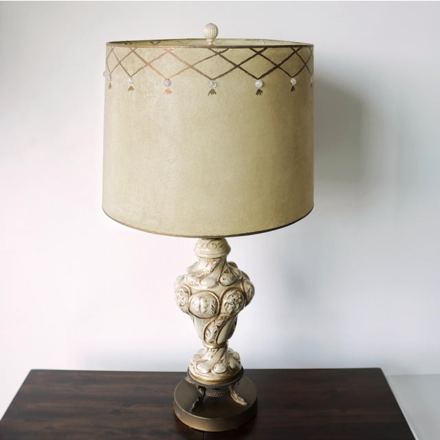 Vintage Mid-Century Porcelain Capodimonte table lamp topped with a rare vintage fiberglass drum lamp shade. a Hollywood...